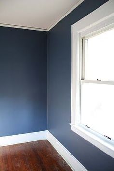 Benjamin Moore Kensington Blue - this is the color I'd like James' chalkboard wall to be for his space room