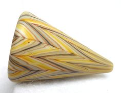 Harold Williams Cooney, American Trade Cone bead, $ 45.00. Hollow blown boro glass lampwork. California Trade Beads are a color study of opposed zanfirico in an organic palate. After the flameworking and coldworking was completed, the item's surface was sandblasted and oiled to give it a pleasingly tactile, natural satin finish. To find all of the California Trade Beads that are available for purchase on the internet: http://www.etsy.com/shop/hwcglass/search?search_query=California