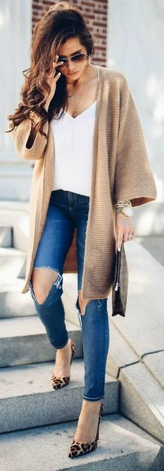 Emily Gemma + perfect blend of comfort + class + gorgeous cable knit cardigan + distressed jeans + statement heels + leopard print + Cardigan: Asos + Jeans: AG Jeans + Shoes: Christian Louboutin.