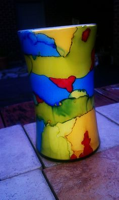 alcohol ink painted to outside of 80 cent vase. white acrylic and poly on inside.