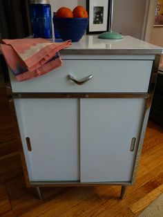 Retro Kitchen Cabinet $50 - Chicago http://furnishly.com/catalog/product/view/id/880/s/freestanding-retro-kitchen-cabinet-with-formica-top-and-chrome-trim/