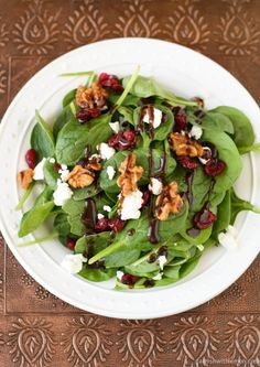 Cranberry, pecan, goat cheese salad: craisens, pecans, greens, goat cheese and fig balsamic from wegmans
