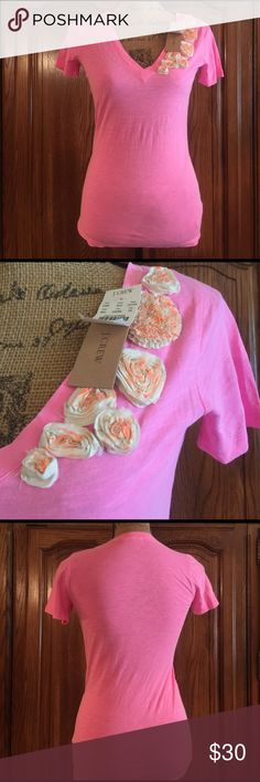 """J. Crew Neo Pink Rosette Embellished Tee NWT size xsmall made of 100% cotton. It measures approximately 16""""flat underarm to underarm and measures approximately 25.5"""" long measured from shoulder to hem J. Crew Tops Tees - Short Sleeve"""
