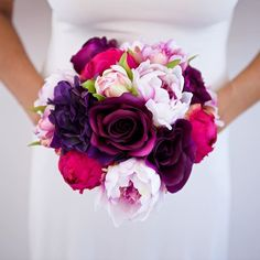 Hello beautiful #weddingbouquet made of silk peonies and roses in shades of fuchsia, pink, and purple! <3
