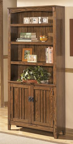 Cross Island Large Door Bookcase by Ashley at Crowley Furniture in Kansas City