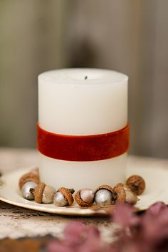 Love the silver acorns and the simple velvet ribbon-wrapped candle! Perfect for a fall celebration...  Photography by redbirdhills.com
