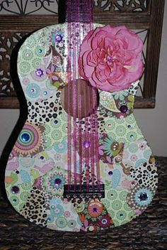 Turn old guitars into gorgeous pieces of art. Very cool idea for my old guitar!