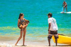 Bathers enjoy at the Perequê beach in Ilhabela, Brazil, on Jan. 8, 2017.