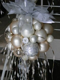 Hot glue ornaments to a foam ball.