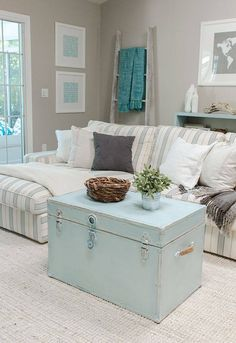 blue trunk and striped fabric and taupe walls