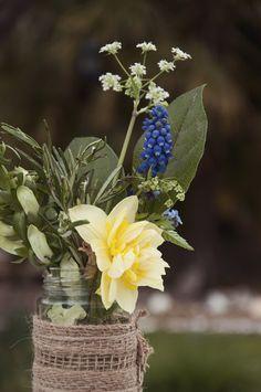 Wedding Jam jar spring flowers wrapped in hessian