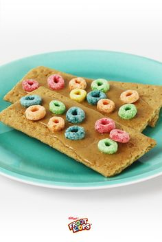 PB&G Bedazzled Froot Loops Sammies. Make a super colorful version of PB&J sandwiches with graham crackers, peanut butter and Froot Loops. Fun to make and yummy to eat!