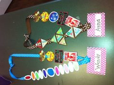 Girl Scout Badge Ceremony! The blue lanyard on left is all the badges/ patches that this Daisy has earned. The brown lanyard on right is all the badges/ patches this Brownie has earned! they used grosgrain ribbon for the lanyard and scrapbook paper for the name tags. they attached the badges with a dot of fabric glue so the moms could pull them off later to attach to the girls sash.