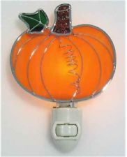 Stained Glass Pumpkin Night Light: Stained Glass Pumpkin Night Light is made from real stained glass and is a bright orange color. Perfect for use from September through Thanksgiving! Stained Glass Night Lights, Stained Glass Ornaments, Stained Glass Suncatchers, Stained Glass Projects, Stained Glass Patterns, Stained Glass Art, Mosaic Glass, Fused Glass, Glass Lights