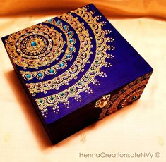 Midnight blue Mandala Keepsake Jewelry Box, Hand- Painted in gold accents and Gemstones. This box is solid wood and inlaid with a foam cushion which is overlaid with either felt or satin as per your choice. **ALL Boxes are shipped with a set of corresponding replacement