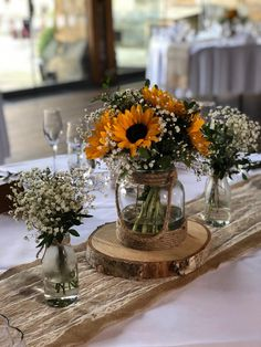 We provided these centrepieces for a sun flower wedding last year. Sunflower Wedding Centerpieces, Rose Centerpieces, Rustic Wedding Flowers, Rustic Wedding Centerpieces, Diy Wedding Decorations, Wedding Cakes With Sunflowers, Sunflower Wedding Flowers, Sun Flower Wedding, Sunflower Party Themes