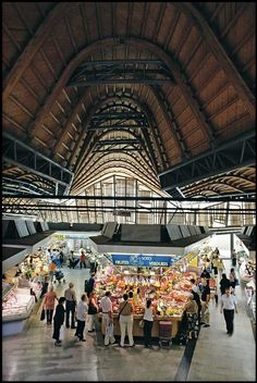 Santa Caterina Market in Barcelona, designed by Enric Miralles & Benedetta Tagliabue Architects, reused part of the existing 1848 market building and enclosed the structure with a distinctive and colorful roof.