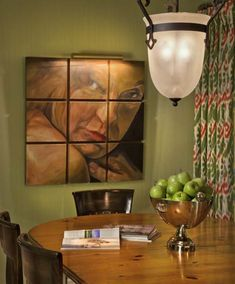 You would never know it but this pine distressed table gets abused daily in this kitchen. The portrait painting is nine individual canvasses and always a topic of conversation for guests. Photo by George Dzahristos. Paul Feiten Design Paul Feiten - Bloomfield Hills, M