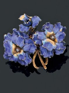 An antique gold, enamel and diamond pansy brooch, circa 1900. #antique