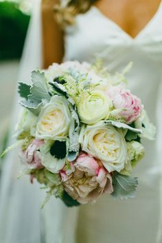 Gorgeous lush mound of garden roses, panda anemones, astilbe and dusty miller make up this perfect bride's bouquet