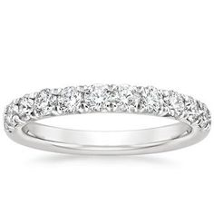 This luminous band features a row of diamonds extending halfway down the shank in a French pavé setting style that allows light to reach the diamonds from multiple angles and enhances their sparkle. Available in White Gold. 8 Carat Diamond Ring, Eternity Ring Diamond, Diamond Bands, Eternity Rings, Platinum Wedding Rings, White Gold Wedding Bands, Diamond Wedding Rings, Wedding Anniversary Rings, Diamond Anniversary Rings