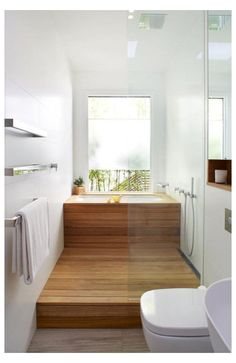 25-cover-a-usual-soaking-tub-with-wood-and-the-shower-space-also-to-achieve-that-Japanese-inspired-look • #japanese #bath #tub #small #bathrooms 25-cover-a-usual-soaking-tub-with-wood-and-the-shower-space-also-to-achieve-that-Japanese-inspired-look • Japanese Bathroom, Modern Bathroom, Small Bathrooms, Japanese Soaking Tubs, Small Bathroom Ideas, Small Soaking Tub, Long Narrow Bathroom, Japanese Shower, Small Bathroom Interior