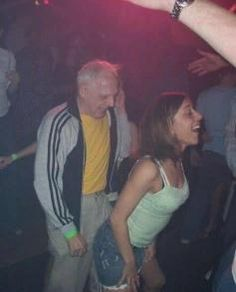 There Goes My Hero In This Picture: Photo of old man dancing with young girl