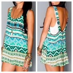 """SHOW ME YOUR MUMU Romper Printed Tank Top Jumpsuit Size Medium. New With Tags. $145 Retail + Tax.  Gorgeous printed romper with back zipper.  Unlined, however not completely sheer.   Polyester. USA Made.    Measurements for Size Medium: Length: 32"""" Bust: 36"""" Waist: 27"""" Hips: 33""""     ❗️ Please - no trades, PP, holds, or Modeling.    Bundle 2+ items for a 20% discount!    Stop by my closet for even more items from this brand!  ✔️ Items are priced to sell, however reasonable offers will be…"""