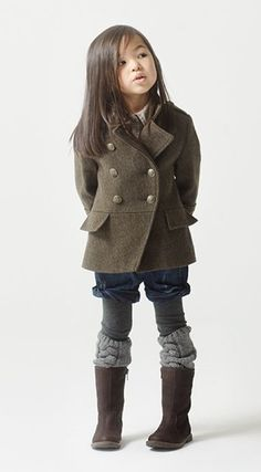 I know, it's a little ridiculous, but i'm pinning this fashonista little girl to remind myself to wear shorts in winter, cause it looks too cute with a peacoat and leg warmers!