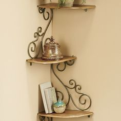 """Beautiful Scrolled #corner #Shelf, wood n #wroughtiron  """"Brighten any corner and give your treasured curios a place of honor with this unique space-saving display. Sturdy goldtone painted tubular metal frame is shaped in graceful scrolls supporting 4 composite wood shelves with goldtone laminate. Each shelf is 12 1/2"""" w x 7 1/4"""" d; overall height is 40""""."""" @wards via @sunjayjk"""