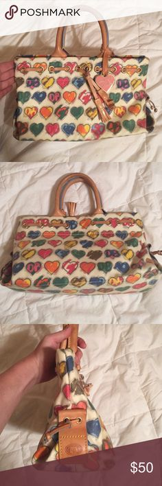 Dooney & Bourke Great condition. Clean bag . Authentic 12x7. Coated canvas Dooney & Bourke Bags