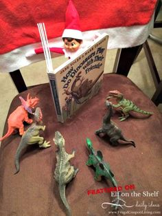 elf-on-the-shelf-ideas-elf-reads-to-dinos-frugal-coupon-living We want you! Send us your Funny, Easy, and Creative Elf on the Shelf Ideas. Hundreds of ideas found on Frugal Coupon Living. Noel Christmas, Christmas Elf, Christmas Humor, Christmas Countdown, Christmas Crafts, Modern Christmas, Christmas Activities, Christmas Traditions, Funny Christmas Decorations