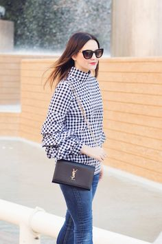 Statement sleeves are the 'IT' trend this season. Caroline styles a ruffle sleeve gingham top.