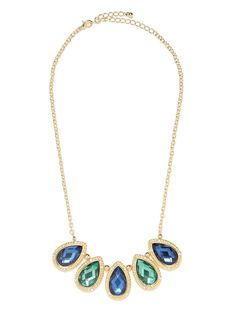 There are many a splendid thing about this necklace, including the large teardrop jewels it flaunts, the surrounding gold, ropey boarder, and a surprising touch of crystal detailing.