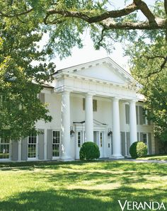 A look at the exterior of a white-columned Greek Revival Dallas house decorated by Julie Hayes, with renovation architecture by Larry E. Boerder Architects. - Veranda.com