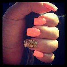 Tangerine with a dash of glitter makes for a perfect manicure for summer time