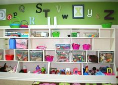 Locker and Hutch combination for toy rooms. The lower open bins allow for bulkier items while still having the option for clear bin storage above. Brilliant!