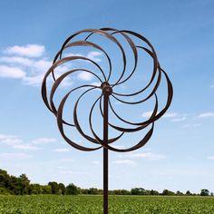 Windmills Home Locomotion The summer breeze will dance in your yard or garden when captured by this gorgeous iron windmill. The spinning petals stand seven feet tall and create a wind-powered spectacle of style. Item weight: 10 lbs. 24 x 10 x 84 high. Iron. UPC: 039138029119.  Some Assembly Required.