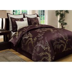 Lend a luxurious touch to your bedroom decor with this luxurious eight-piece comforter set. A lovely leafy vine pattern in warm tan and purple hues highlight this elegant set.