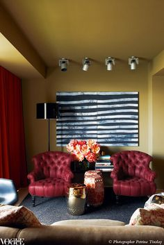 Living Room Decorating Ideas Burgundy Sofa coffee table, blue grasscloth wallpaper, wall sculpture, chevron