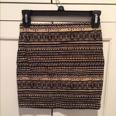 Forever 21 Skirts - NEW! Tight, Black and Tan mini skirt with prints.