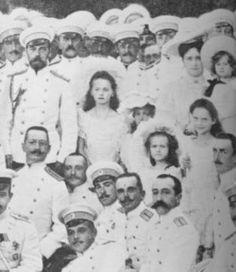 Left: The Imperial Family with sailors on the Standart, 1906.    From left: Nicholas, Grand Duchesses Olga, Maria, Anastasia, and Tatiana, Alexandra Feodorovna, and Alexei.