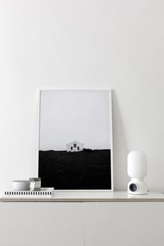 A picture of a lonely house on a grass hill, photographed in Iceland.Size: 50cm x 70cm - printed on 170 g Art print paperStamped and signed on the back with the Coco Lapine logo.The print...