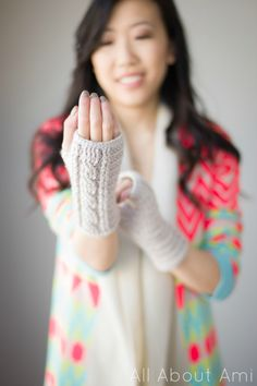 Cabled fingerless gloves @ All About Ami. I love everything she makes!! :)