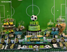 Amazing dessert table and backdrop at a soccer birthday party!  See more party planning ideas at CatchMyParty.com!