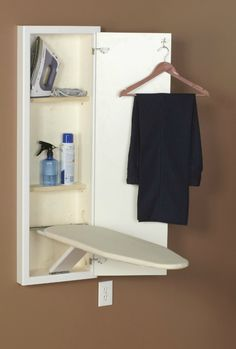 Household Essentials stow away in wall ironing board that folds out for use when you need it, and then goes back into the cabinet in your wall when not in use {featured on Home Storage Solutions 101}