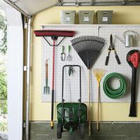 A securely mounted pegboard system will get your tools — rakes, hoses, even wheelbarrows — off the floor and out of the way, plus you'll always be able to see what you have. Via Good Housekeeping