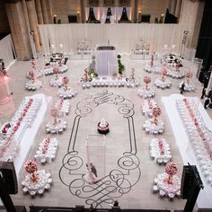 Two large tables that seated 40 people were situated on either side of the room with smaller tables mixed in between them. Lisa & Logan in Chicago, Illinois | Featured on The Knot