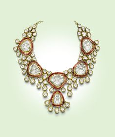 A Royal Jadau necklace crafted with uncut Diamonds and hand set Ruby stones in hand beaten 22 carat yellow gold.