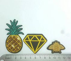 Shape: Pineapple, Gem and bee mix Size: largest - Pineapple approx 37mm x 70mm Colour: Black Yellow and Gold Quantity: 3 per pack mixed as shown, one of each design  Perfect for this seasons applique trend. Lots of other designs available to mix and match like cactus, emojis, text banners & roses. Please refer to my shop policy section for shipping information. I offer postage discount on additional items bought.  Please convo me if you require a quantity not shown and I'll see what I ca...
